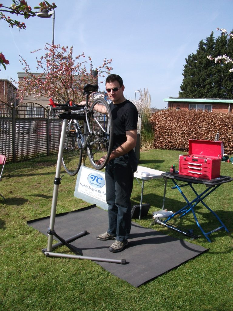 Man checking / servicing a bike