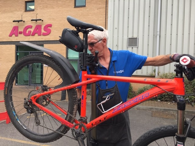 Man inspecting/servicing a bicycle