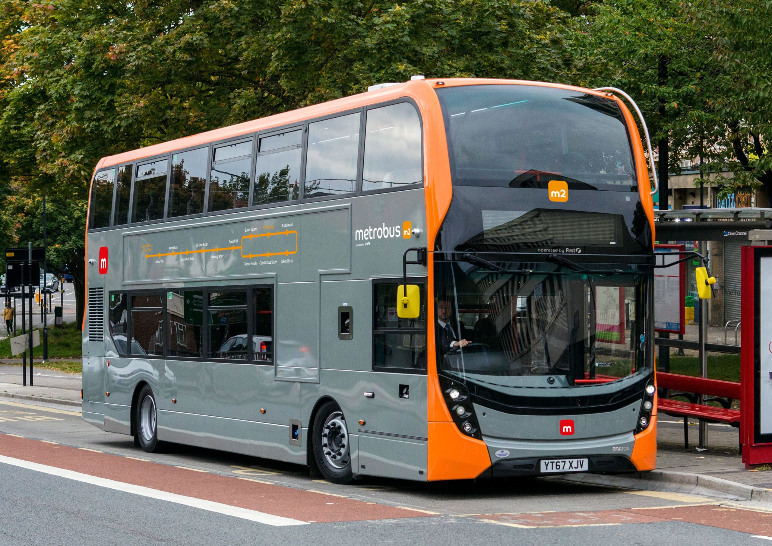 photo of an orange and grey metrobus m2 bus at a bus stop