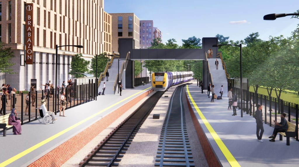 Artist illustration of view of North Filton Station from the rail tracks. People are standing and sitting on benches on the platforms of both sides and there's a train approaching showing North Filton as destination. We can see the footbridge over the tracks, connecting both platforms, with the two pillars for access lifts. To the right there is a green area with big green trees and a sheltered waiting area. To the left there are big tall buildings, with the closest one showing a tall sign which reads 1 Brabazon, and people standing and walking near a sheltered cycle parking area and sheltered waiting area.