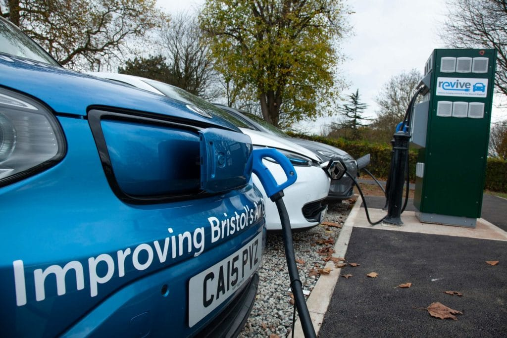 3 electric vehicles in a row plugged in to a revive charge point