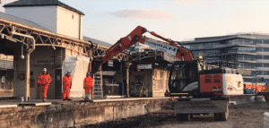 Workmen and machinery at the construction site for a new eastern entrance at Bristol Temple Meads Station