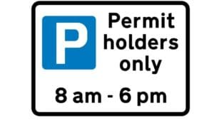 Parking for permit holders only sign. 8am - 6pm.