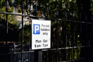 Parking for permit holders only sign. Mon - Sat. 9am - 7pm.